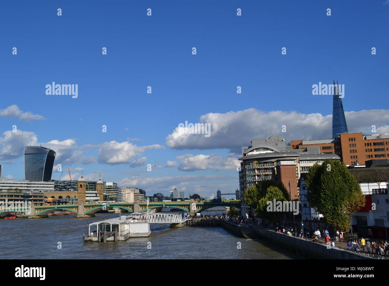 London/UK - August 31, 2014: Beautiful panoramic view to the Thames river, City of London, London bridge, the Shard and embankment on blue sunny sky. - Stock Photo