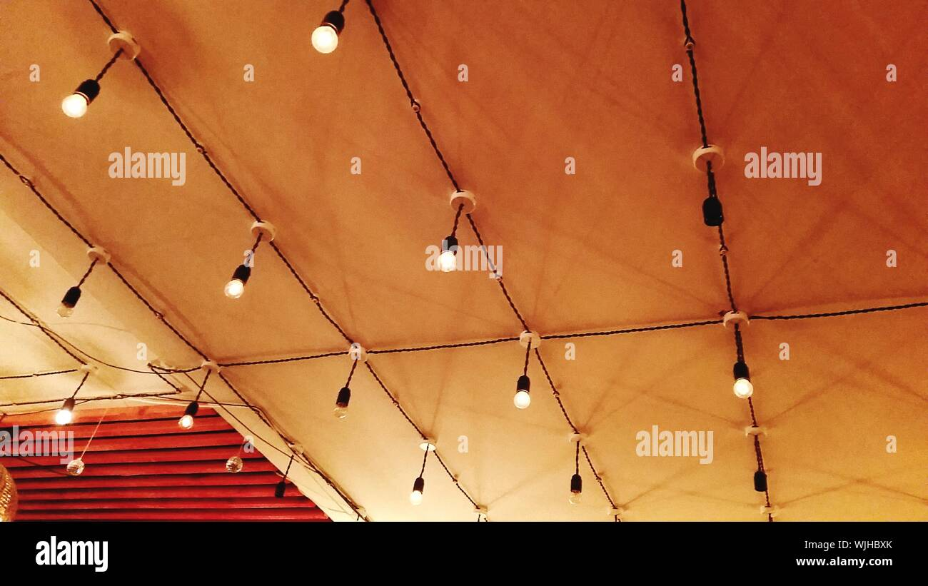Low Angle View Of Illuminated String Lights On Ceiling Stock Photo Alamy