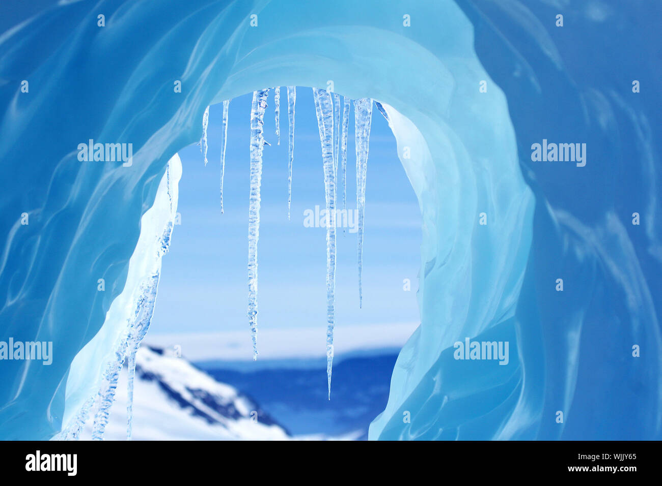 Icicles hanging from an iceberg on Antarctica Stock Photo
