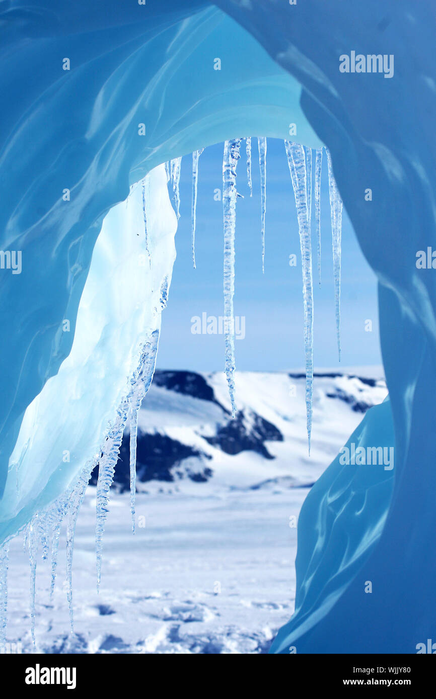 Icicles hanging from an iceberg on Antarctica - Stock Photo