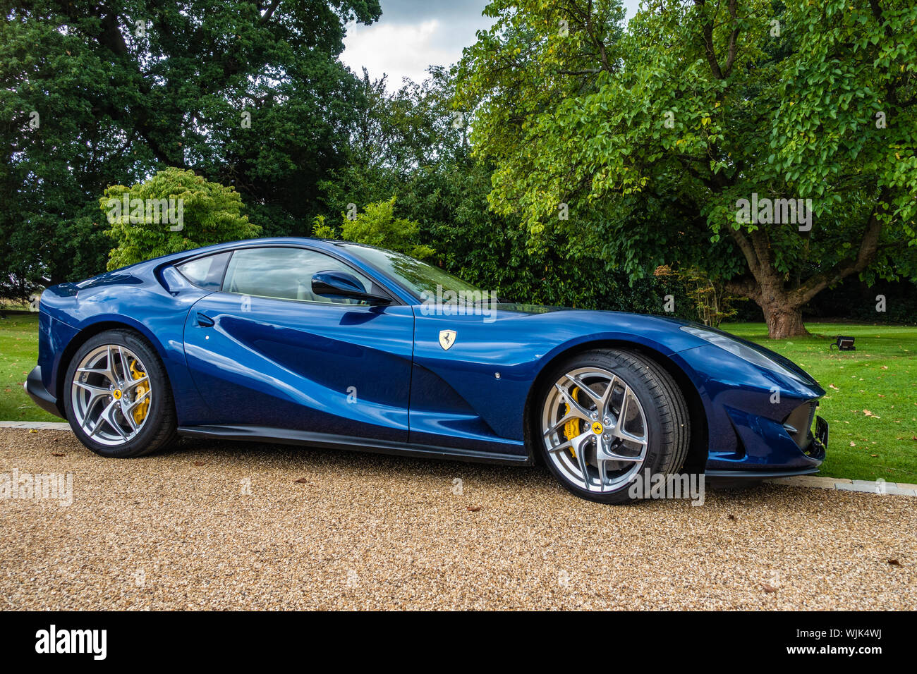 Side view of a 2019 blue Ferrari 812 superfast s,a on a