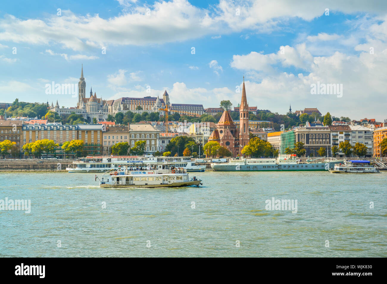 The Szilágyi Dezso Square Reformed Church on the banks of the Danube River in Budapest Hungary with the Castle District, St Matthias Church above Stock Photo