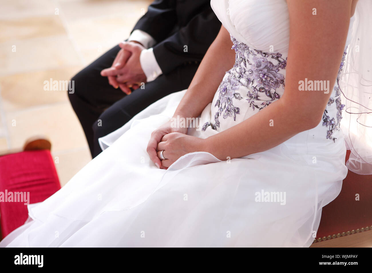 Midsection Of Couple At Wedding Stock Photo