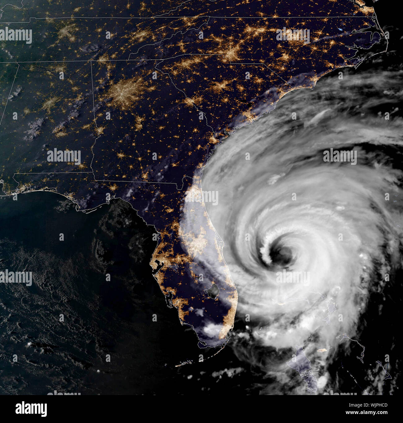 The NOAA GOES-16 satellite showing a night view of catastrophic Hurricane Dorian as it begins moving up the coast of Florida as a Category 2 storm September 3, 2019 in the Atlantic Ocean. Dorian struck the small island nation as a Category 5 storm with winds of 185 mph and has now downgraded to Category 2 and is slowly creeping along the coast of Florida. Credit: NOAA/Planetpix/Alamy Live News Credit: Planetpix/Alamy Live News Stock Photo
