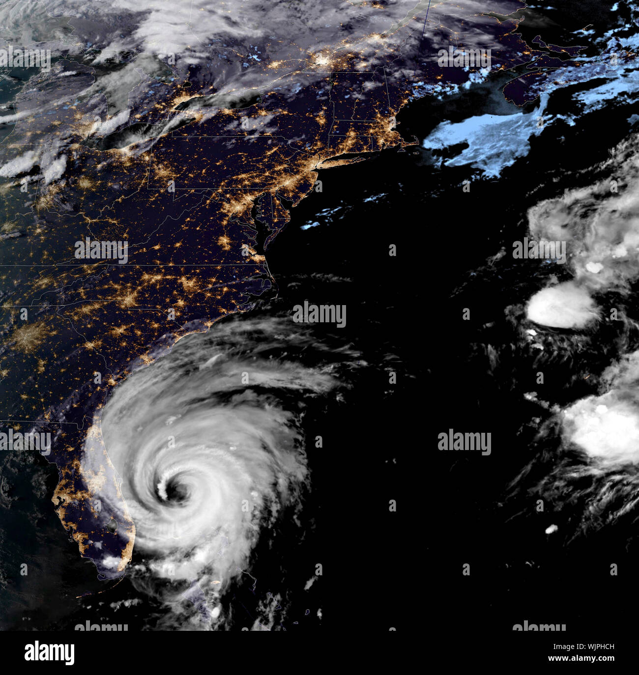 The NOAA GOES-16 satellite showing a night view of catastrophic Hurricane Dorian as it begins moving up the coast of Florida as a Category 2 storm September 3, 2019 in the Atlantic Ocean. Dorian struck the small island nation as a Category 5 storm with winds of 185 mph and has now downgraded to Category 2 and is slowly creeping along the coast of Florida. Credit: NOAA/Planetpix/Alamy Live News Credit: Planetpix/Alamy Live News - Stock Photo