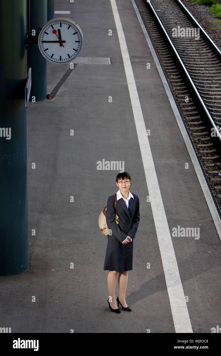 Asian business woman traveller on a trip at the train station Stock Photo