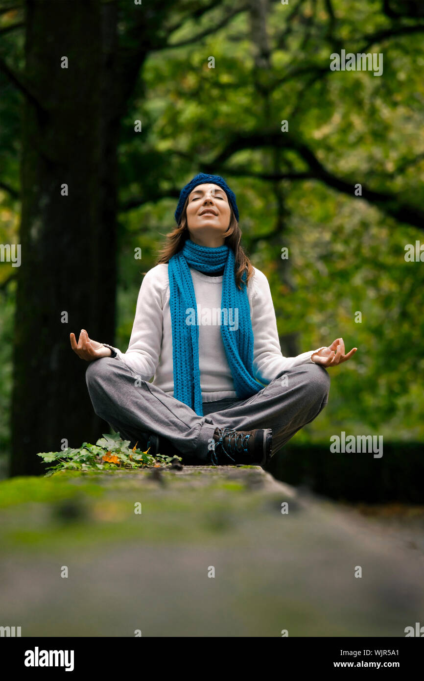 Beautiful Young Woman In Nature Making Meditation Exercises Stock Photo Alamy