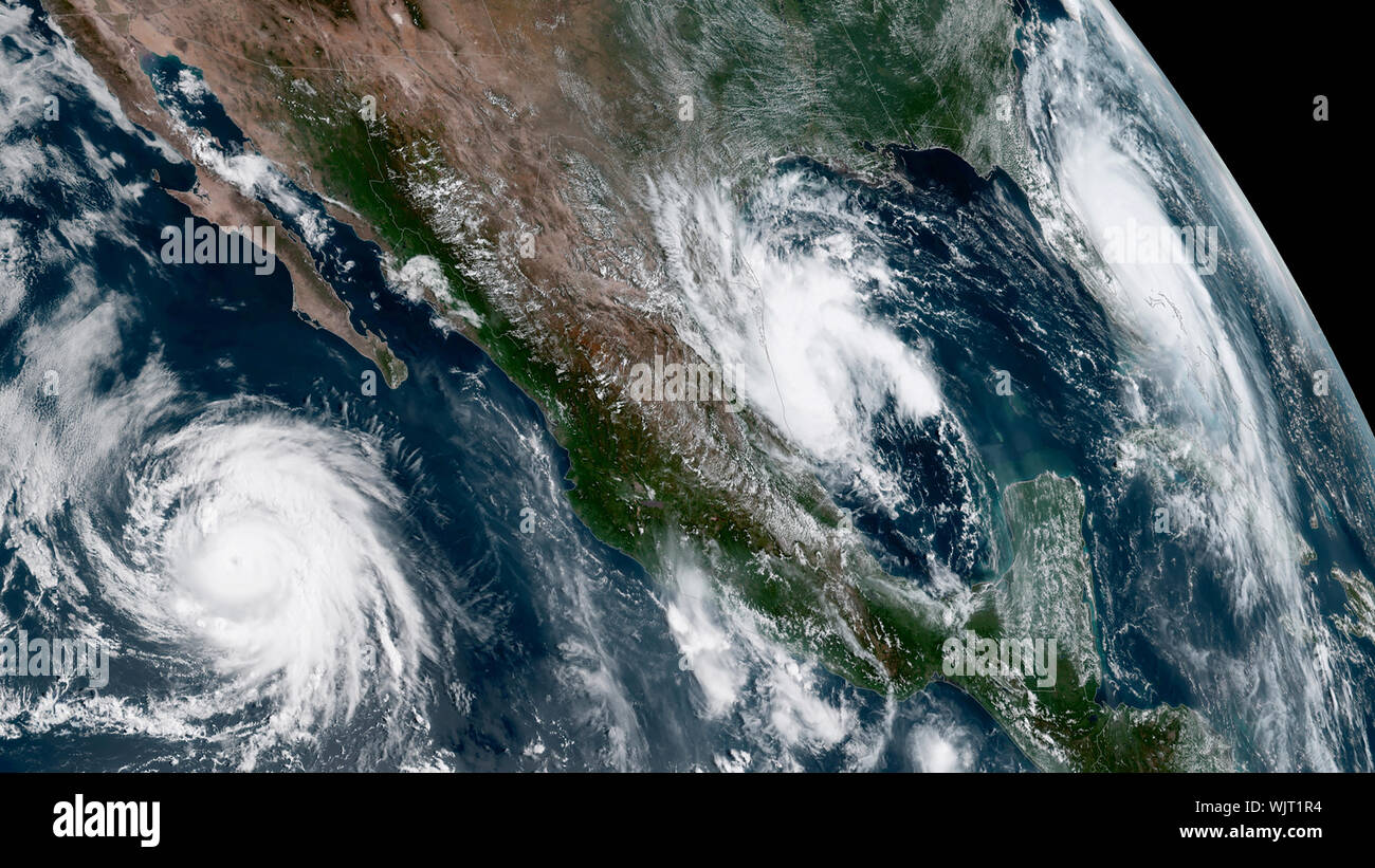 NOAA satellite view (L to R) of Hurricane Juliette (Pacific), Tropical Storm Fernand (Gulf), and Hurricane Dorian (Atlantic) on September 3, 2019. Stock Photo