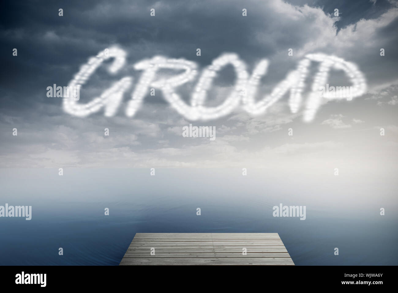 The word group against cloudy sky over ocean Stock Photo