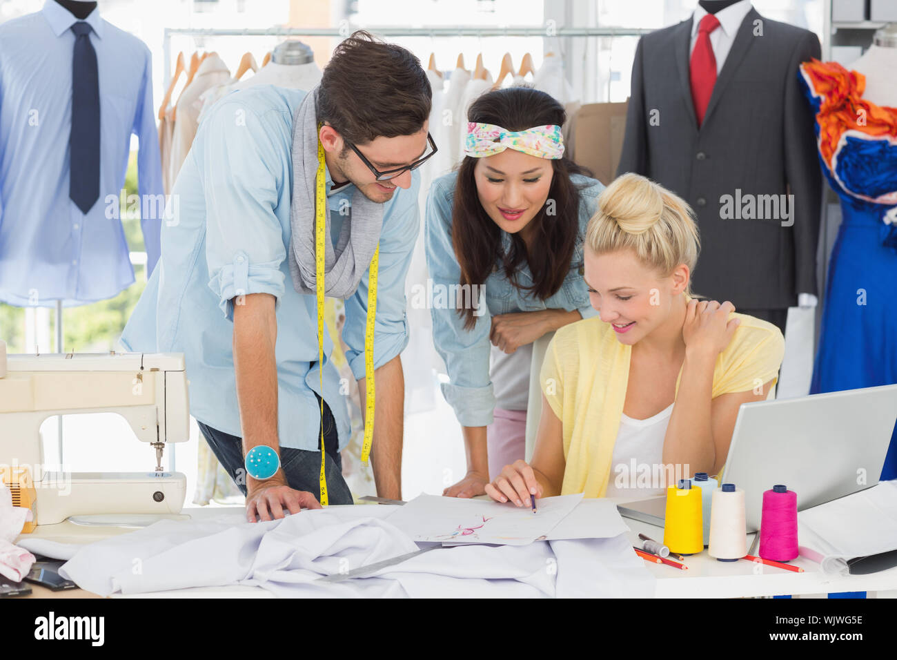 Group Of Fashion Designers At Work In A Studio Stock Photo Alamy