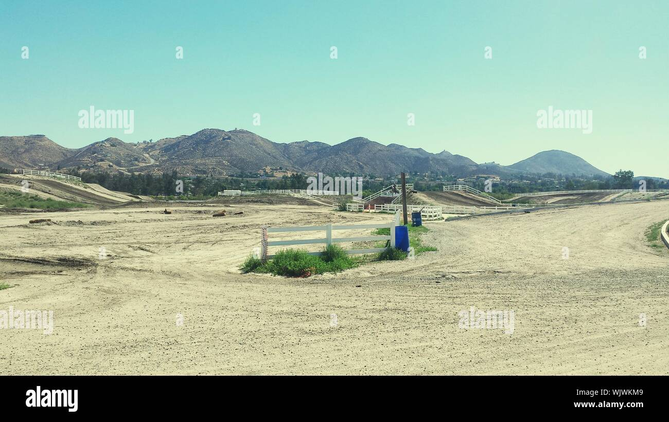 Motor Racing Track Against Clear Sky Stock Photo