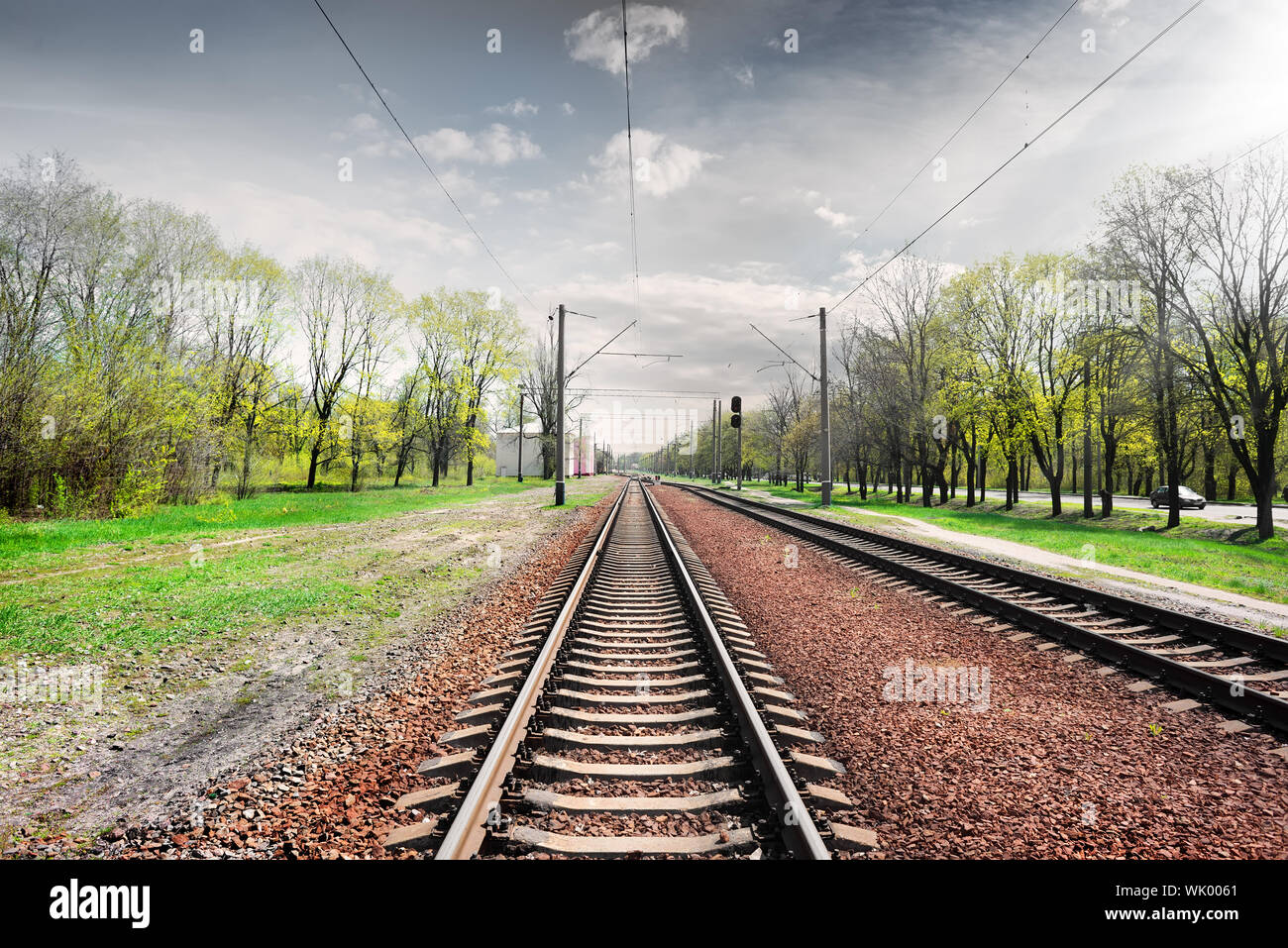 Gray cloudy sky over railroad in spring Stock Photo