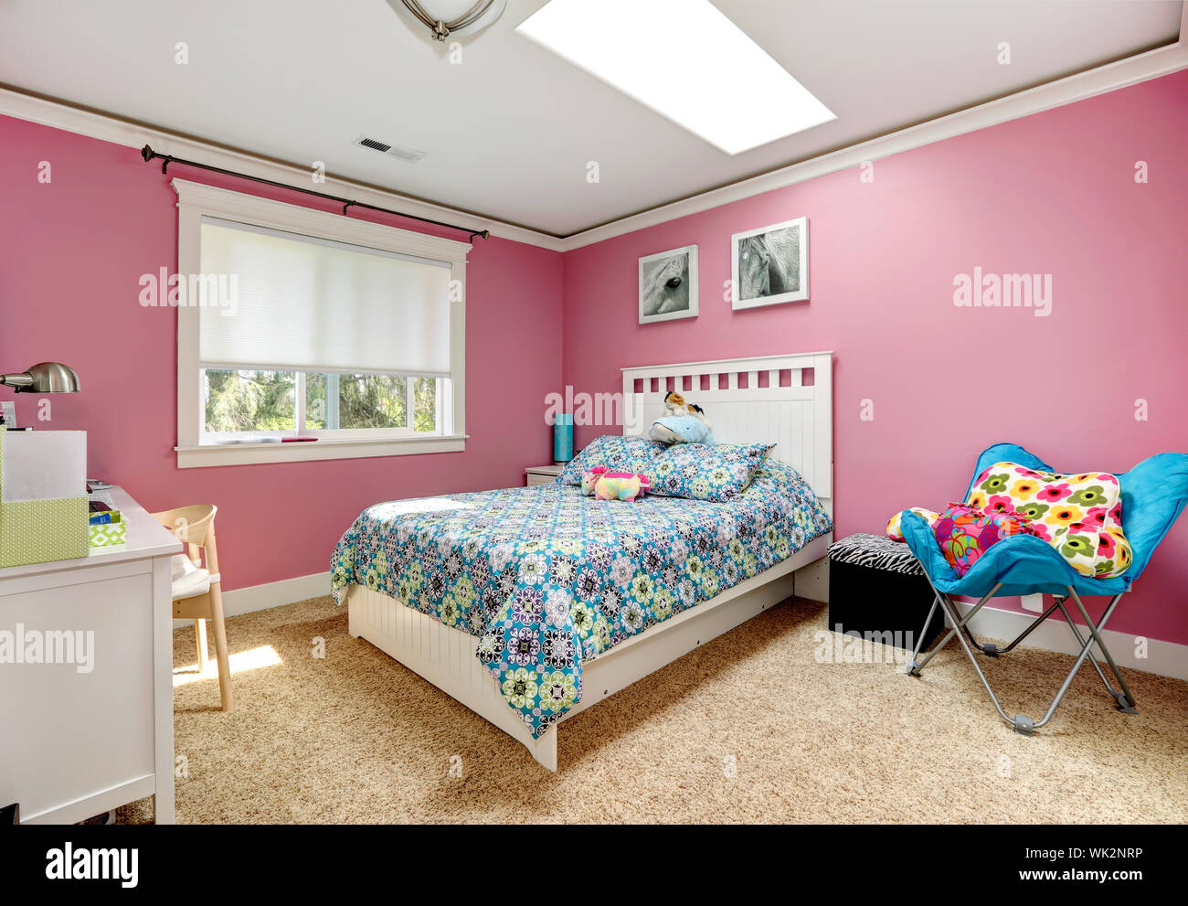 Gentle girls bedroom with white bed and pink walls. View of ...