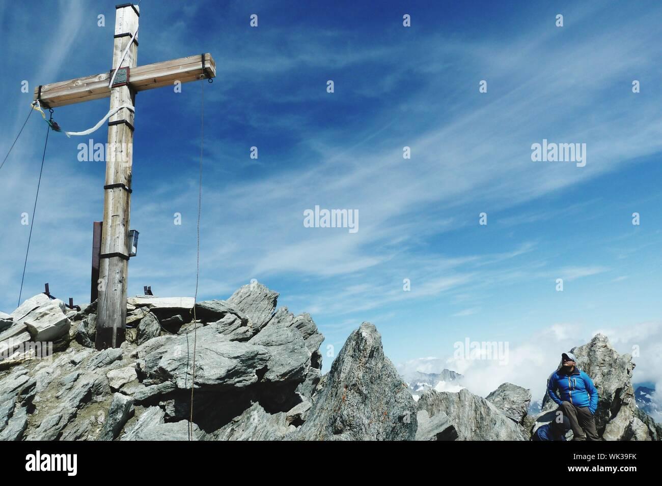 Cross On Rock At Hochfeiler Against Sky Stock Photo
