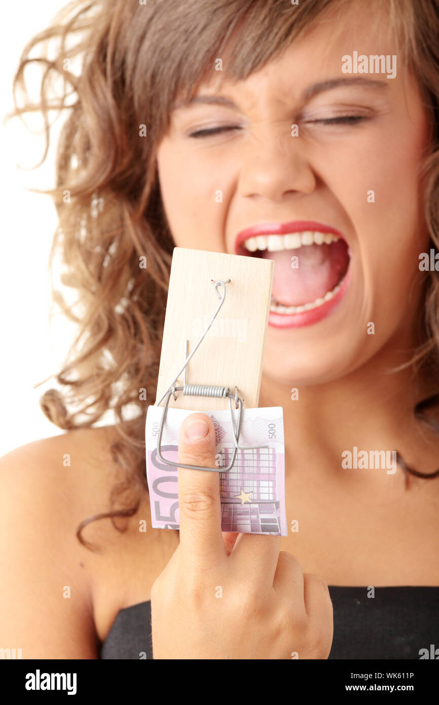 Screaming woman after geting traped by mouse trap with 500 euro Stock Photo