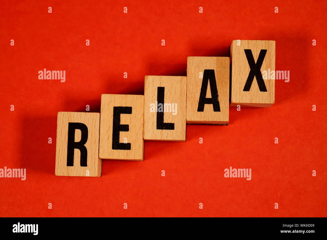 Relax - yoga Word Written In Wooden Cube. cube with letters. dice with text. relaxation concept for spa or health. Yoga, meditation, calm, relax, Stock Photo