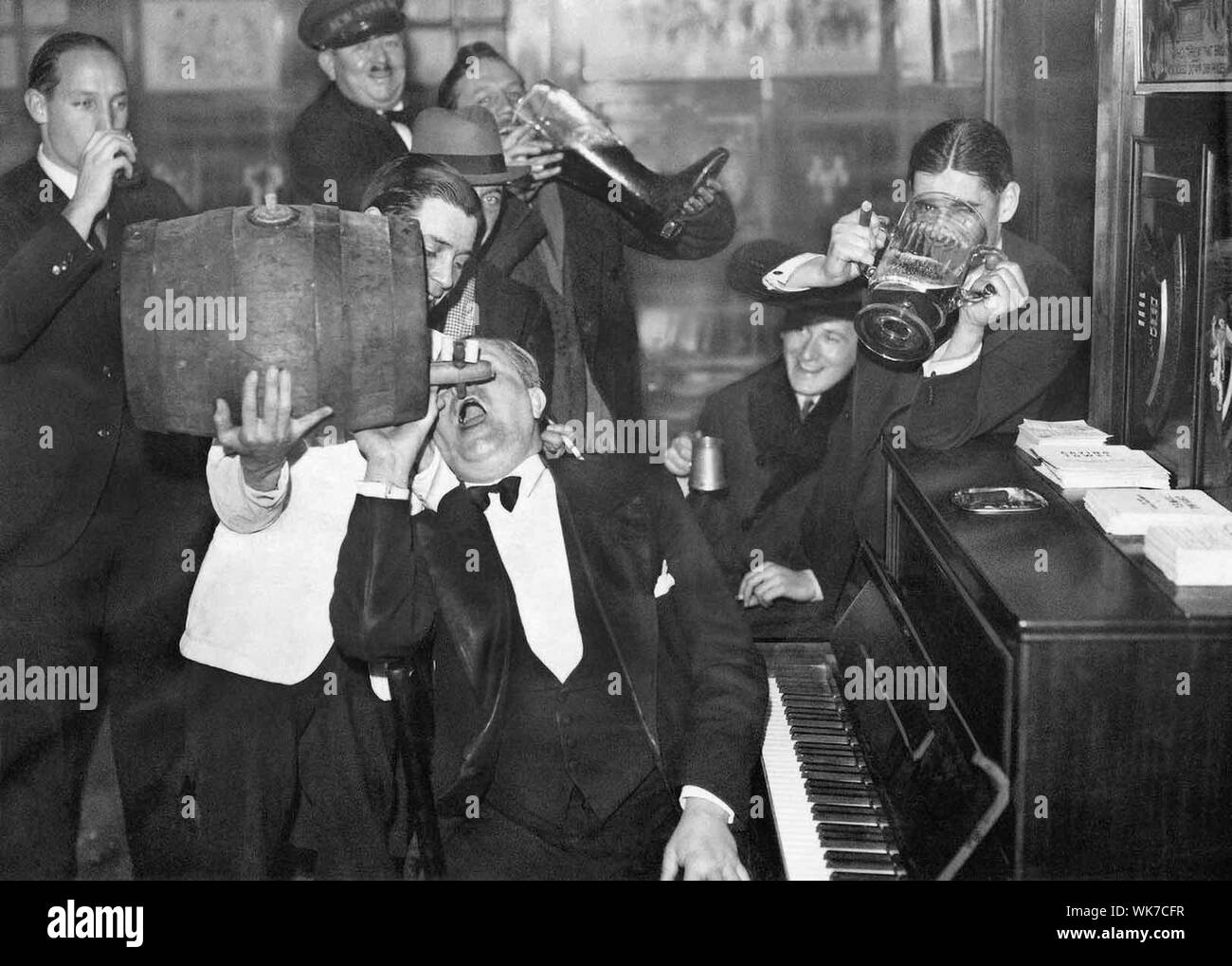 "Americans visiting Paris celebrated the end of Prohibition in the United States in a ""real two-fisted manner,"" its original caption stated. - Stock Photo"