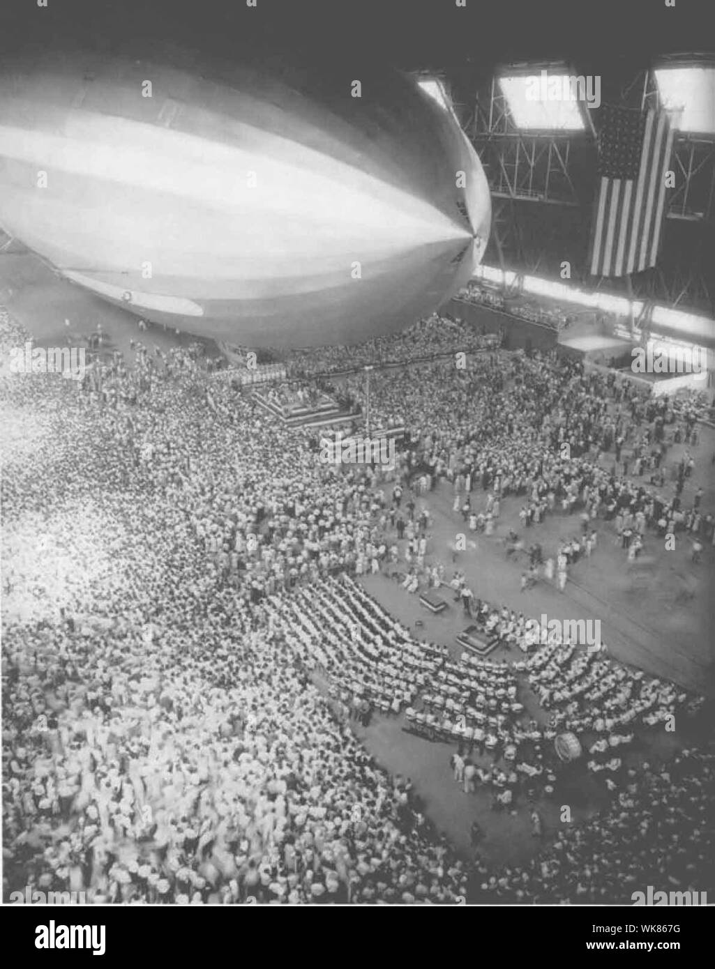 Commissioning ceremony for either the USS Akron or the USS Macon. These ridged airships, were flying aircraft carriers, that's the difference between them and blimps. Blimps were the K-Ships, the ZP Squadron. Stock Photo