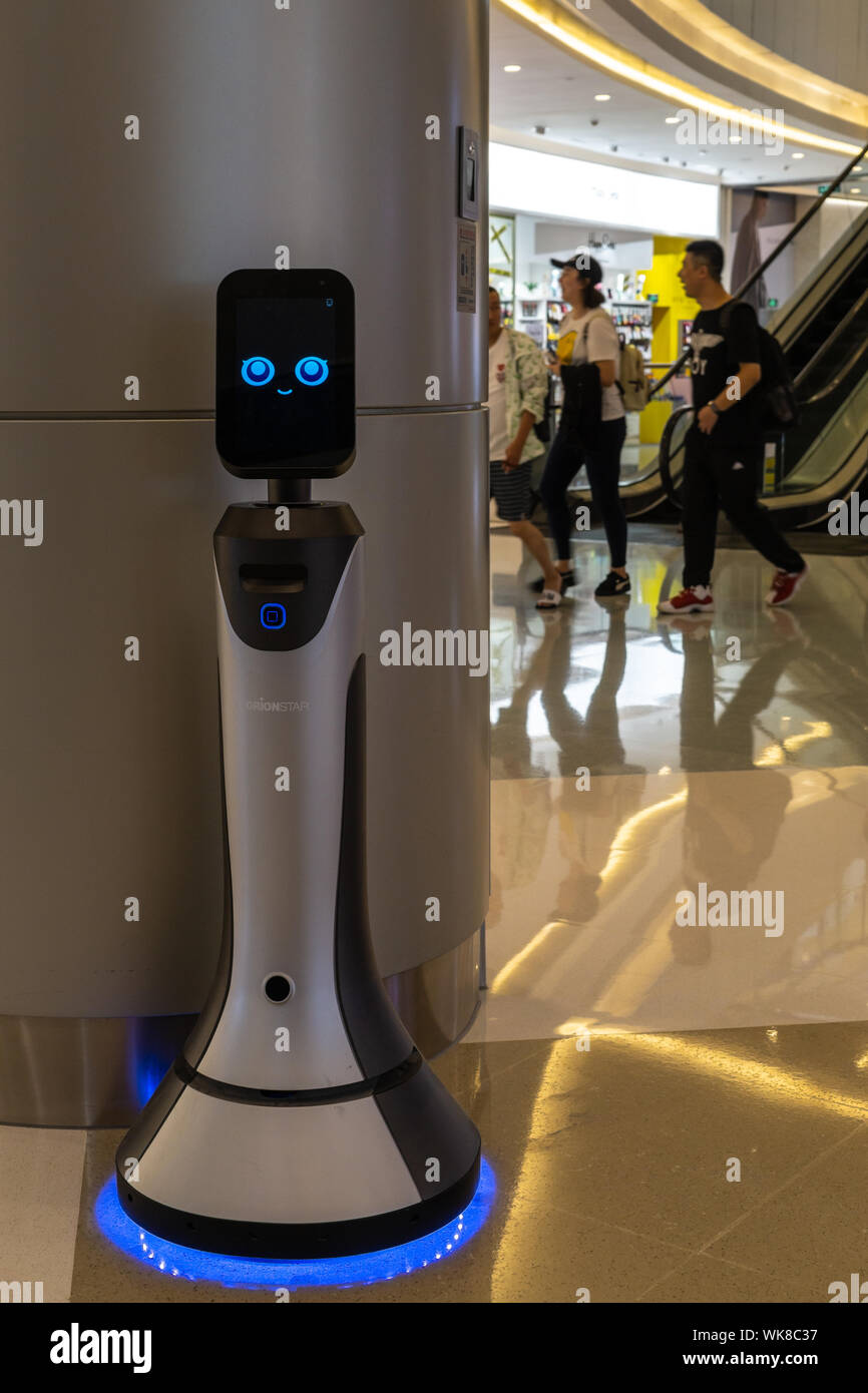 Smiling robot in service at a high end shopping mall in Shenzhen, China Stock Photo