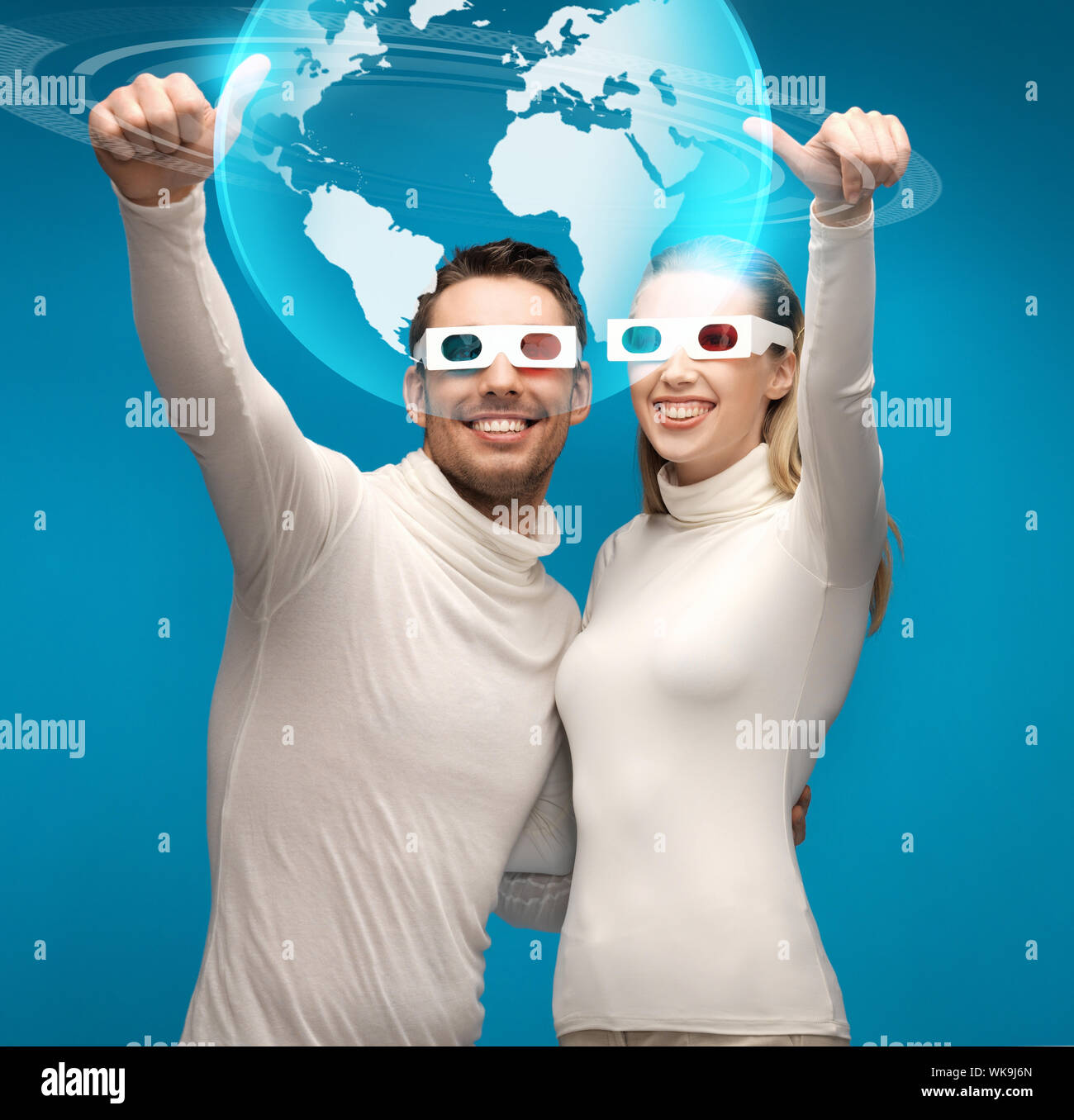 woman and man in 3d glasses looking at globe model Stock Photo