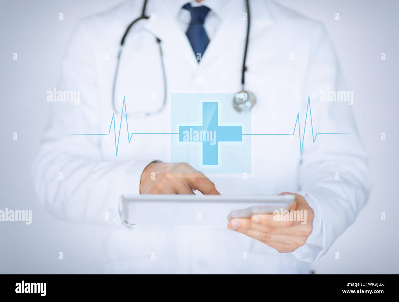 male doctor holding tablet pc with medical app Stock Photo