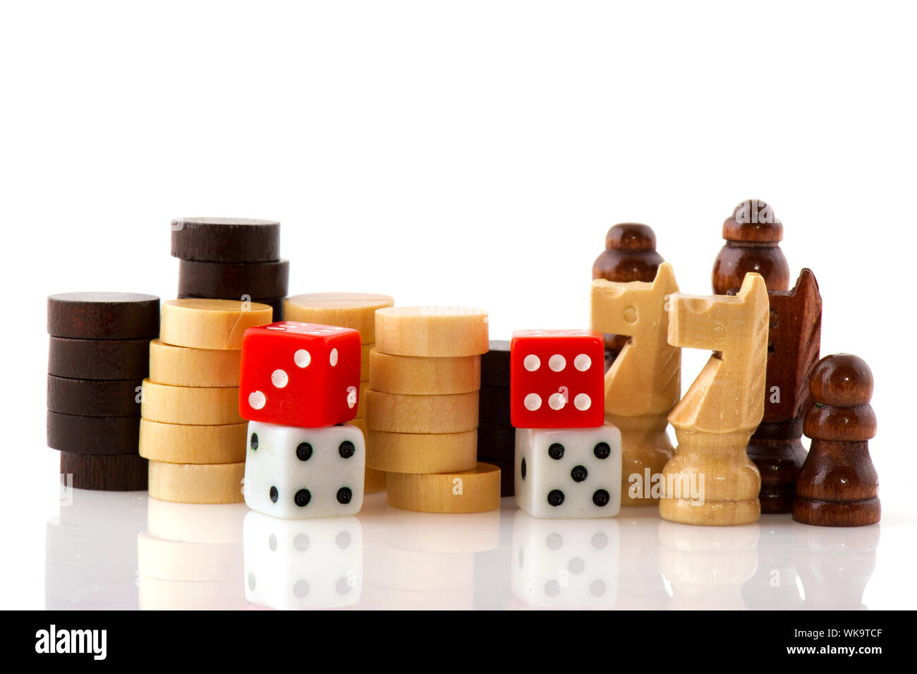 Playing games with wooden chess pawns checkers and dices isolated over white Stock Photo