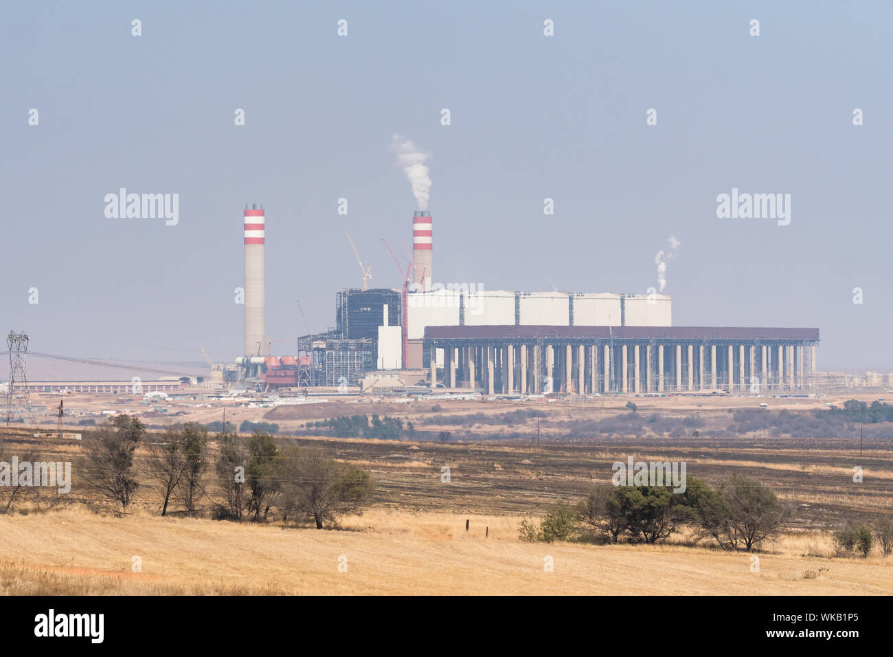coal fired power station belonging to state run owned enterprise ESKOM on the outskirts of Johannesburg,Gauteng,South Africa billowing smoke pollution Stock Photo