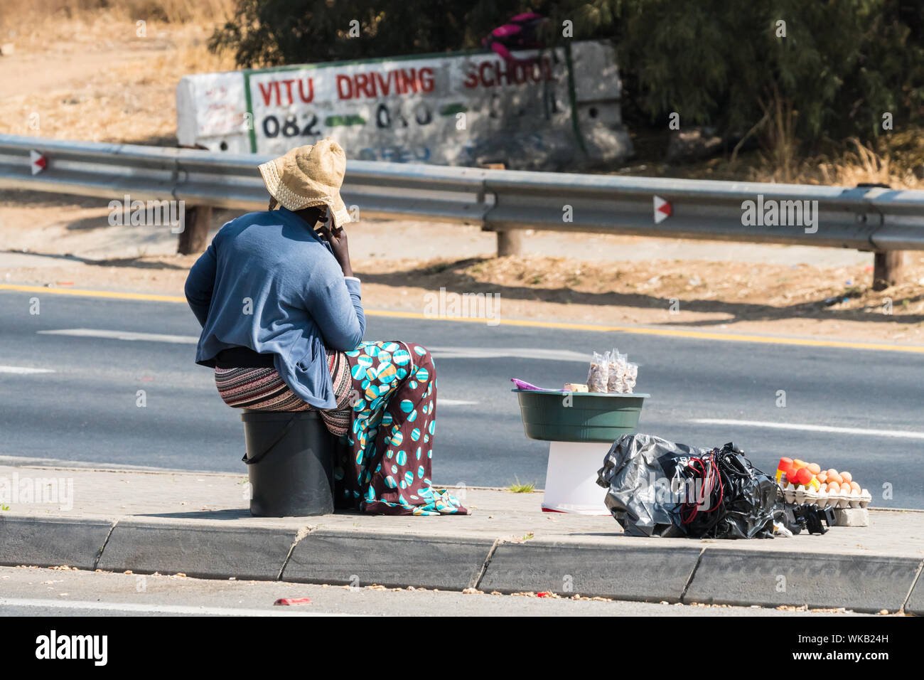 black African street vendor or seller in the road in Johannesburg, Gauteng, South Africa concept daily life in Africa Stock Photo