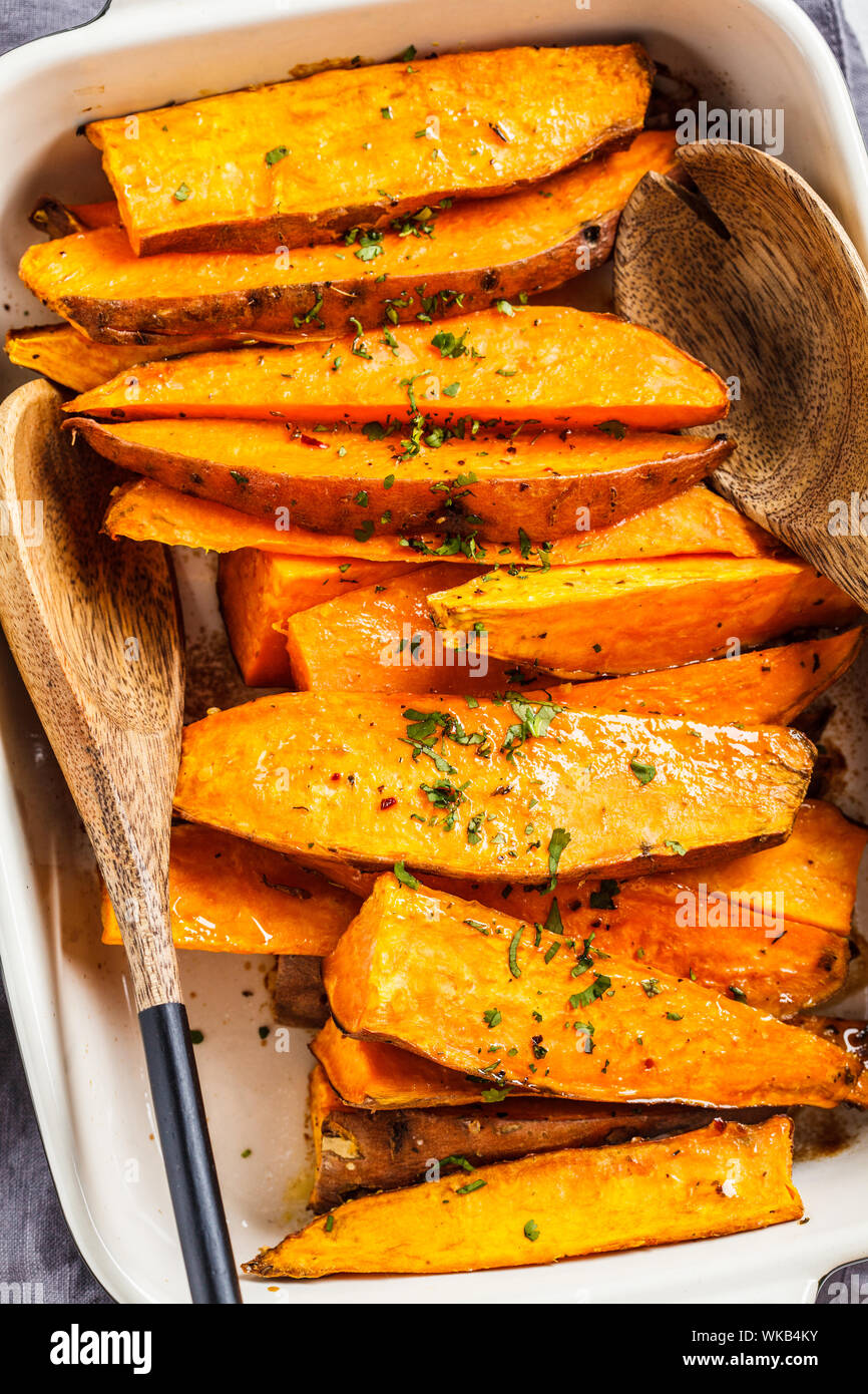 Baked Sweet Potato Slices With Spices In The Oven Dish Healthy Vegan Food Concept Stock Photo Alamy
