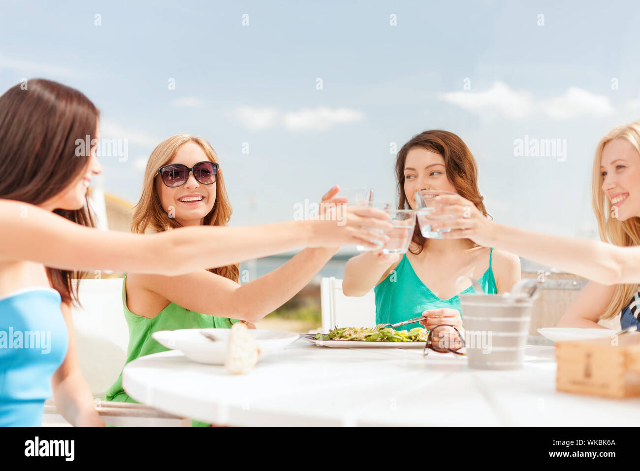 Summer Holidays And Vacation Concept Girls Making A Toast