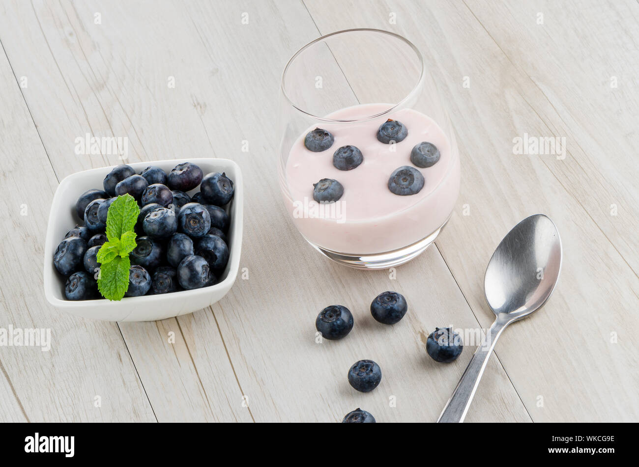 Yogurt With Fresh Blueberries On A Wooden Table Set Stock Photo