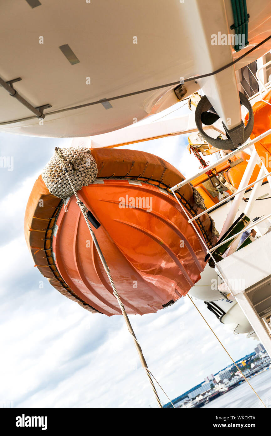 Ribbed fast rescue craft on Queen Mary 2 qm2 sitting on davits. Stock Photo