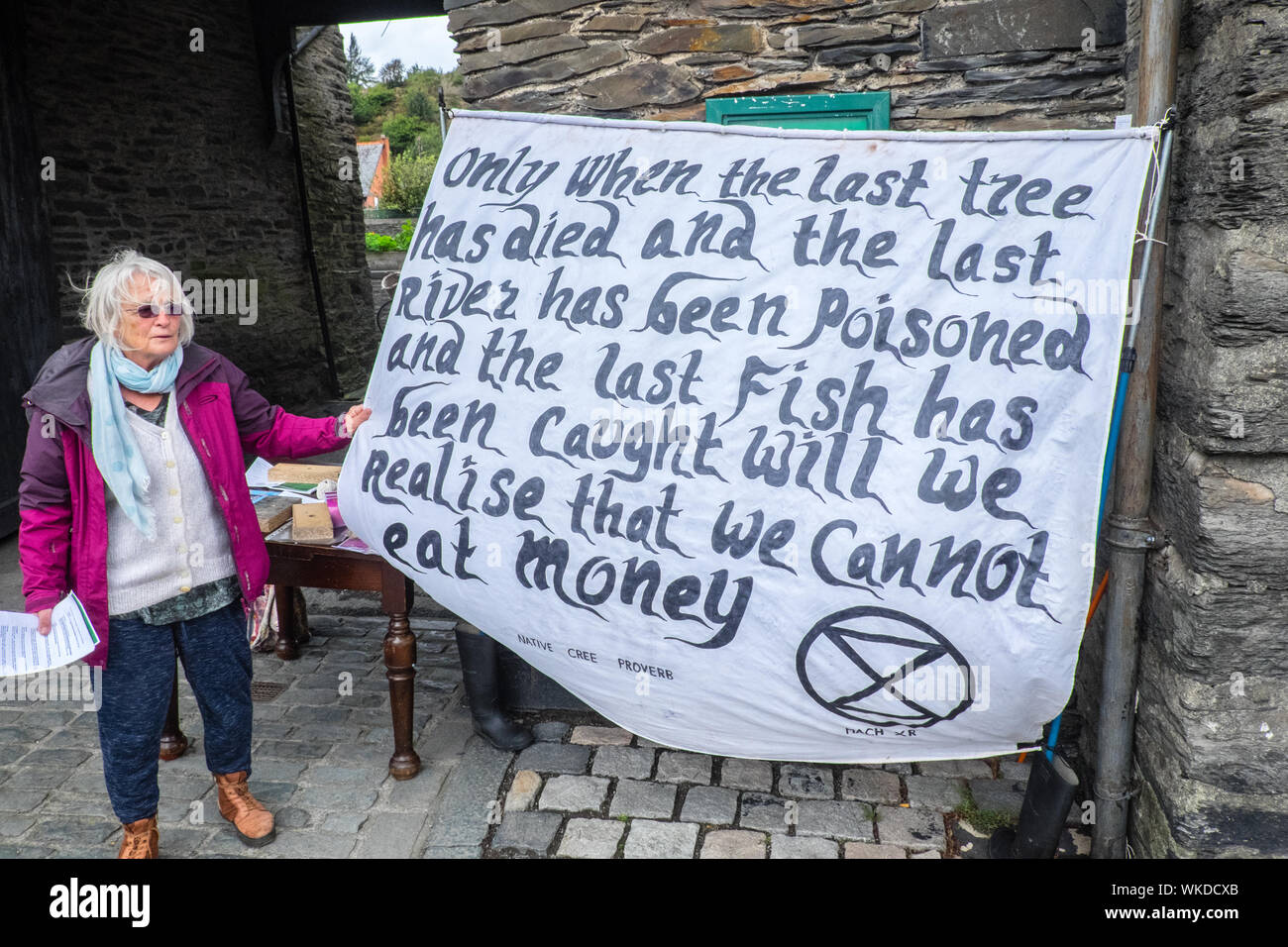 Extinction Rebellion,supporter,supporters,collecting,signatures,for,a,campaign,to,show, support,for,climate,emergency,awareness,in,Machynlleth,Wales - Stock Photo