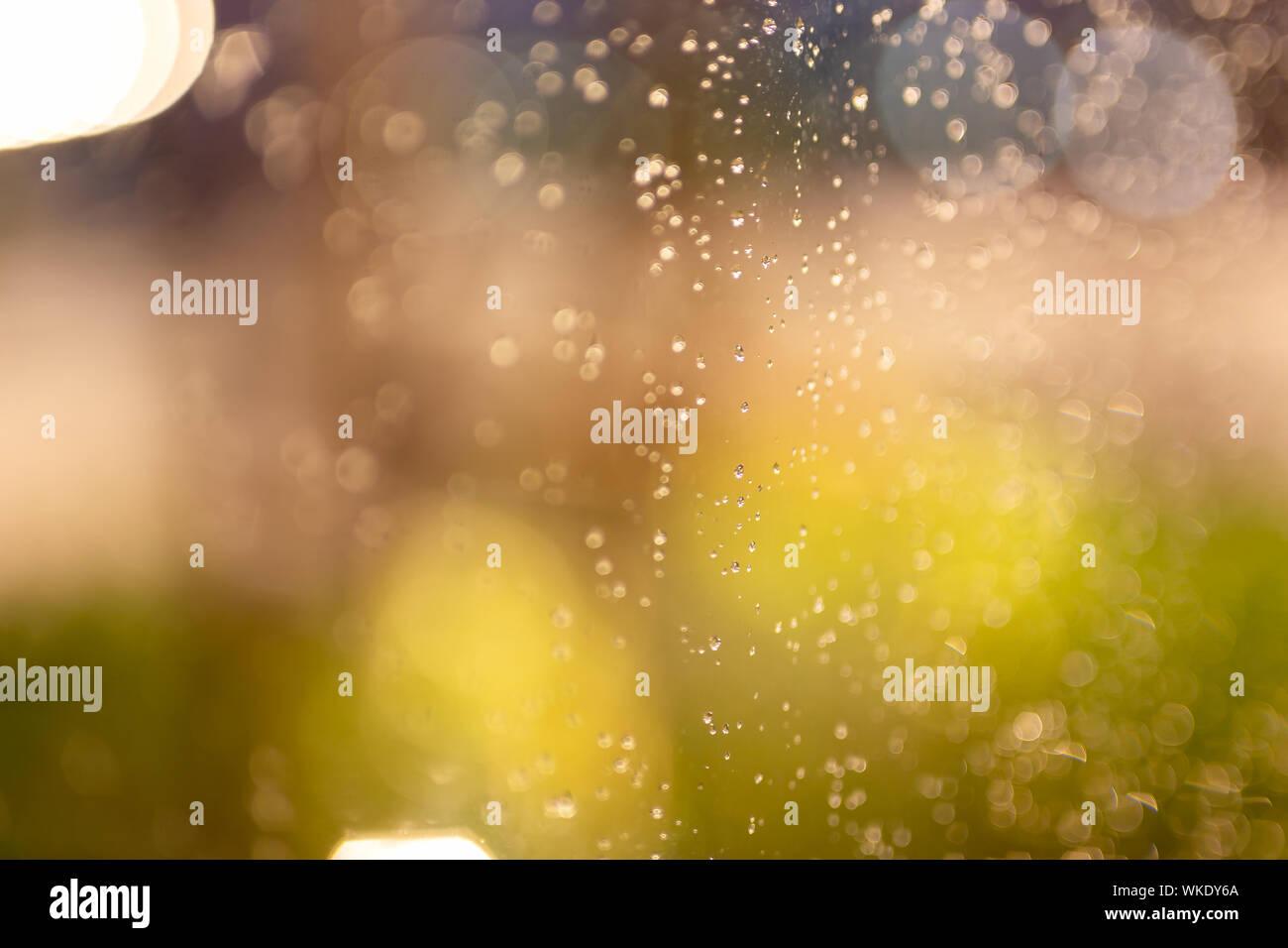 Water Rain Drops On Window Glass With Colorful Bokeh