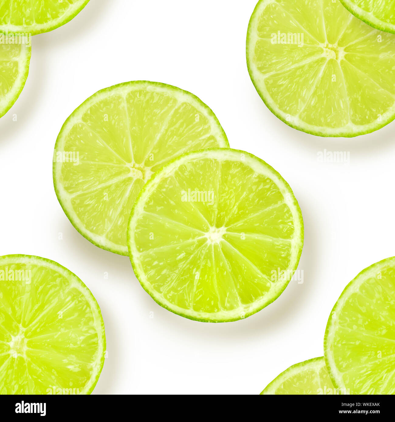 A seamless pattern of lime slices on a white background, a vibrant fruity citrus repeat print Stock Photo