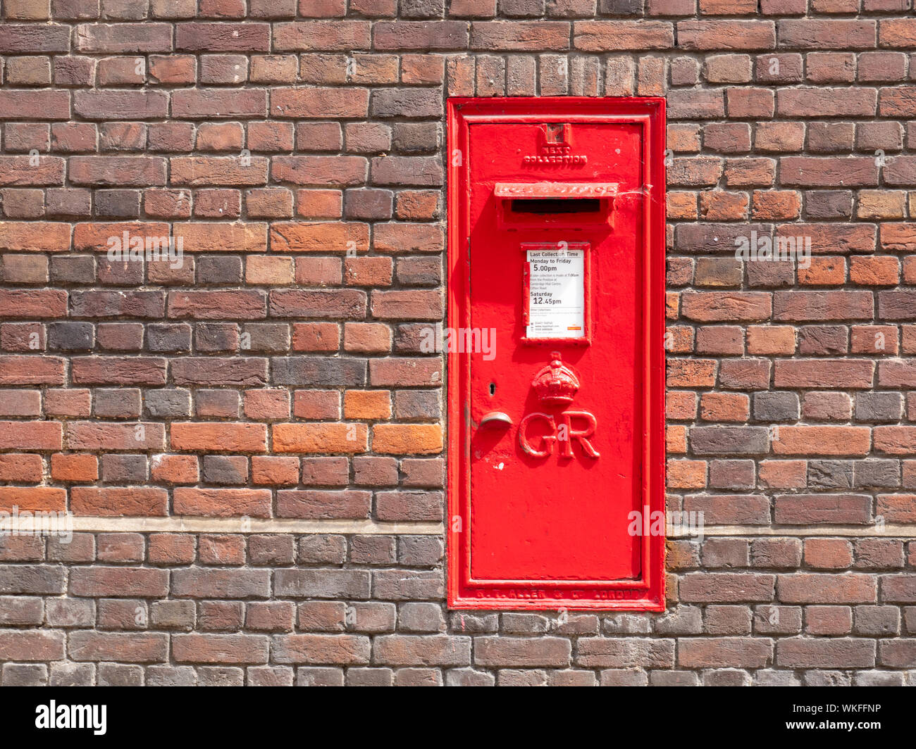 An old GR red post box or mail box set into a brick wall in Cambridge UK Stock Photo