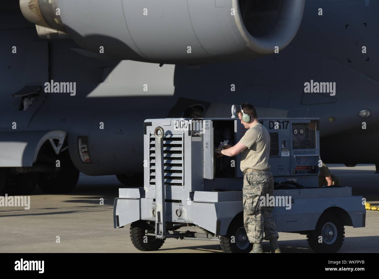 Members of the 145th Maintenance Group prepare the C-17 Globemaster III's to deploy in support of Hurricane Dorian relief in advance of the storms arrival, while at the North Carolina Air National Guard Base, Charlotte NC, 3 Sep. 2019, September 3, 2019. Hurricane Dorian is a Category three storm that caused severe damage to the Bahamas with a projection to hit North Carolina, each year the 145th Airlift Wing responds and prepares for any hurricane in the event of stateside landfall. Image courtesy Airman 1st Class Juan Paz/145th Airlift Wing, Public Affairs North Carolina Air National Guard.  - Stock Photo