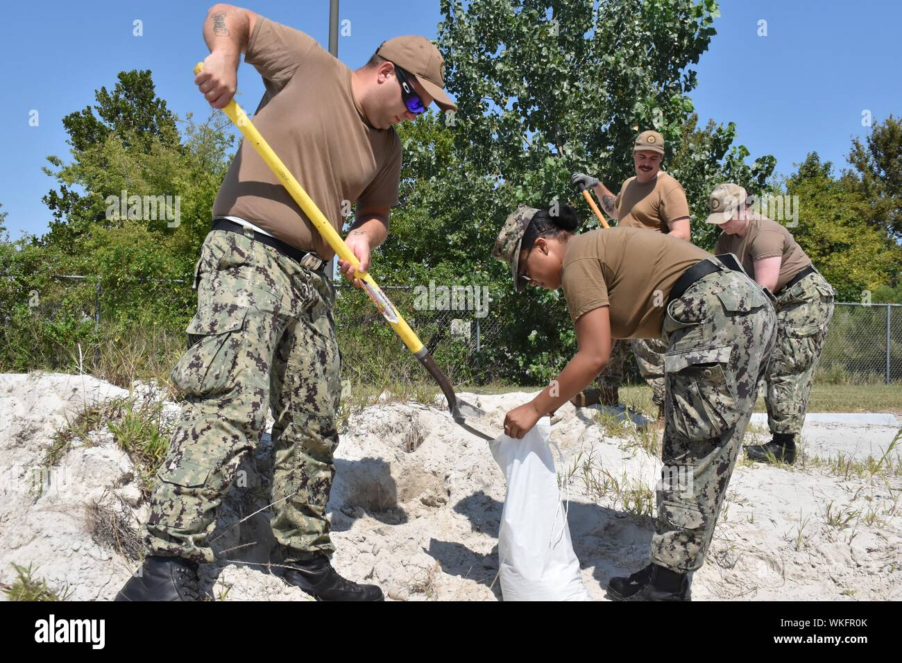Sailors from Naval Support Activity (NSA) Hampton Roads 1st Lieutenant Division fill sandbags in preparation for Hurricane Dorian, September 3, 2019. They also cleared drains and checked for any missile hazards around the base. Image courtesy Katisha Draughn-Fraguada/Naval Support Activity Hampton Roads. () Stock Photo