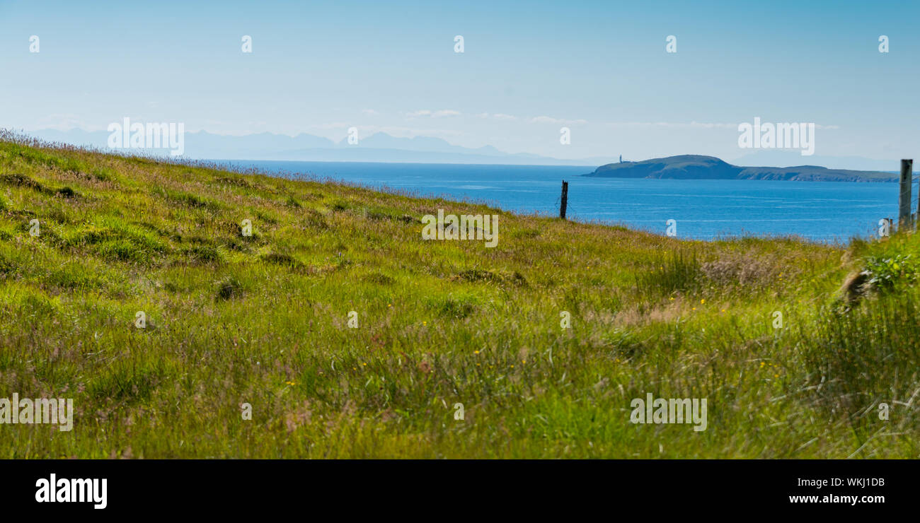 Panoramic view of Minch from east coast cliffs on Hebridean island of Lewis showing lighthouse in mid ground Stock Photo