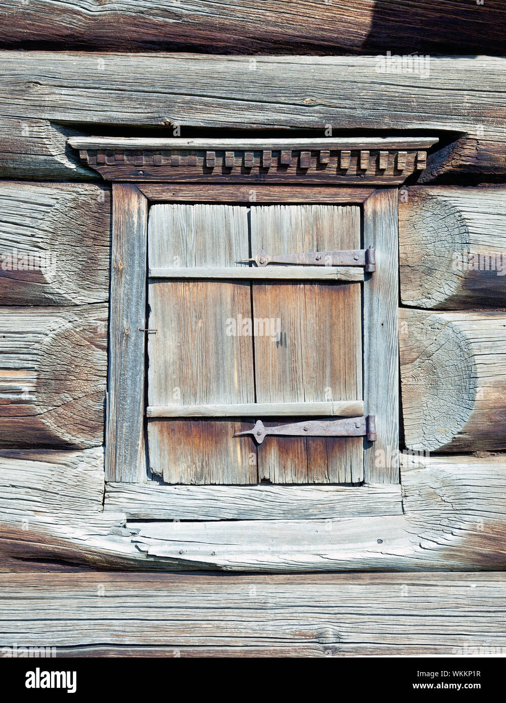 A Small Closed Window In The Wall Of An Old Wooden House