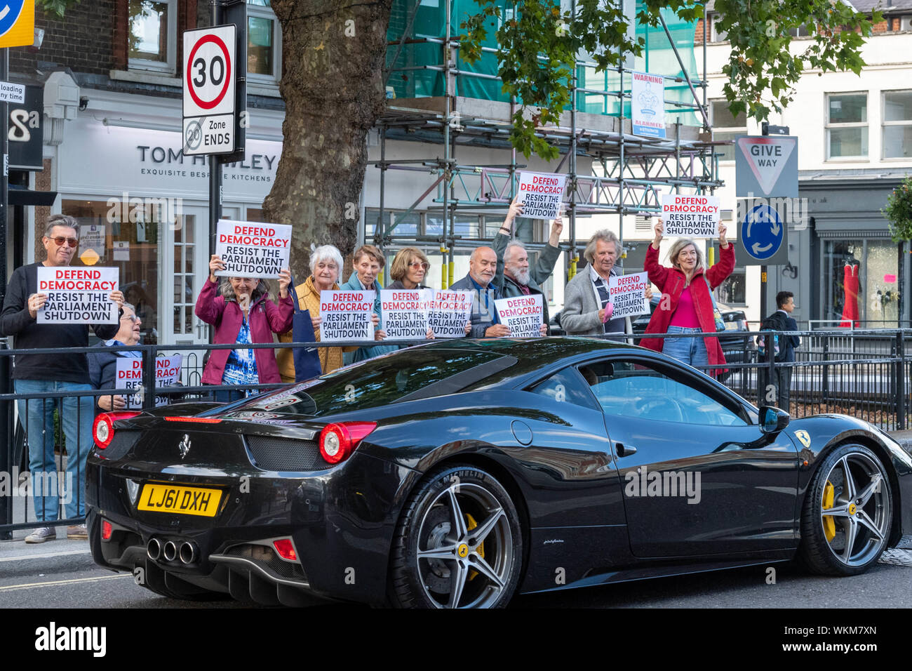 """Brentwood, Essex, UK. 4th September 2019 Mini """"Defend democracy"""" protest in the High Street of Brentwood, Essex, UK with .2012 Ferrari 458 Italia Dct  Credit: Ian Davidson/Alamy Live News Stock Photo"""