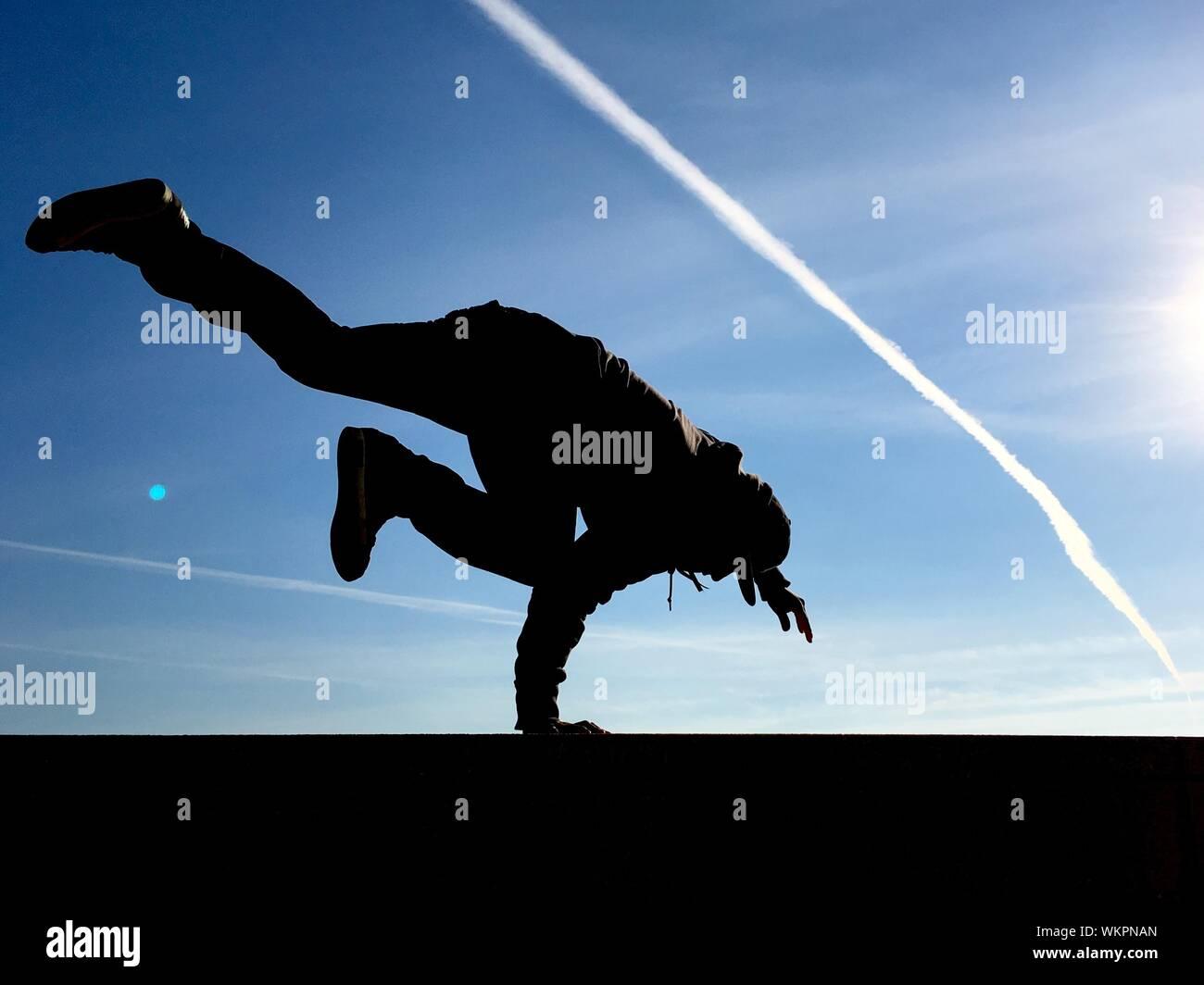 Man Breakdancing Against Sky Stock Photo