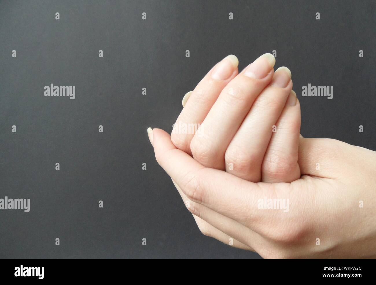 Close-up Of Woman Cupping Hands Stock Photo