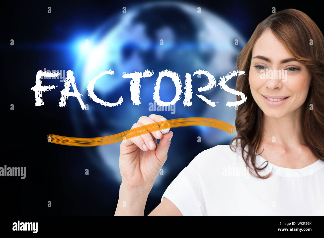Businesswoman writing the word factors against glowing earth with binary code Stock Photo