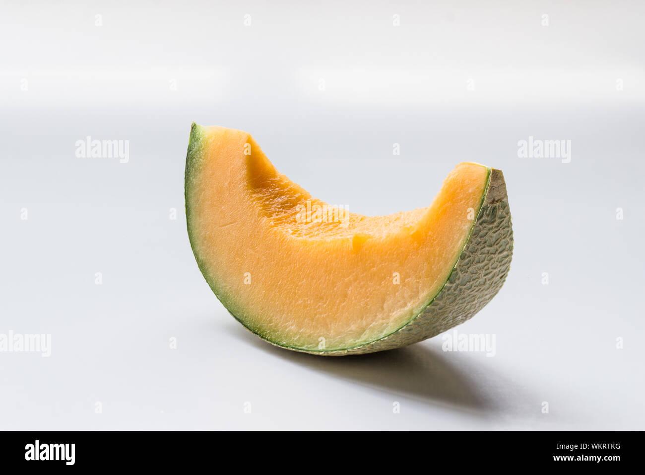 Close Up Of Cantaloupe Slice Against White Background Stock Photo Alamy Cantaloupe slices are food item. alamy