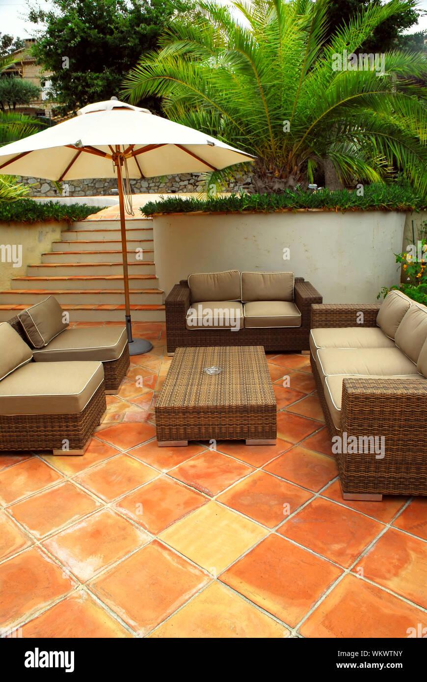Patio of mediterranean villa in French Riviera with wicker furniture Stock Photo