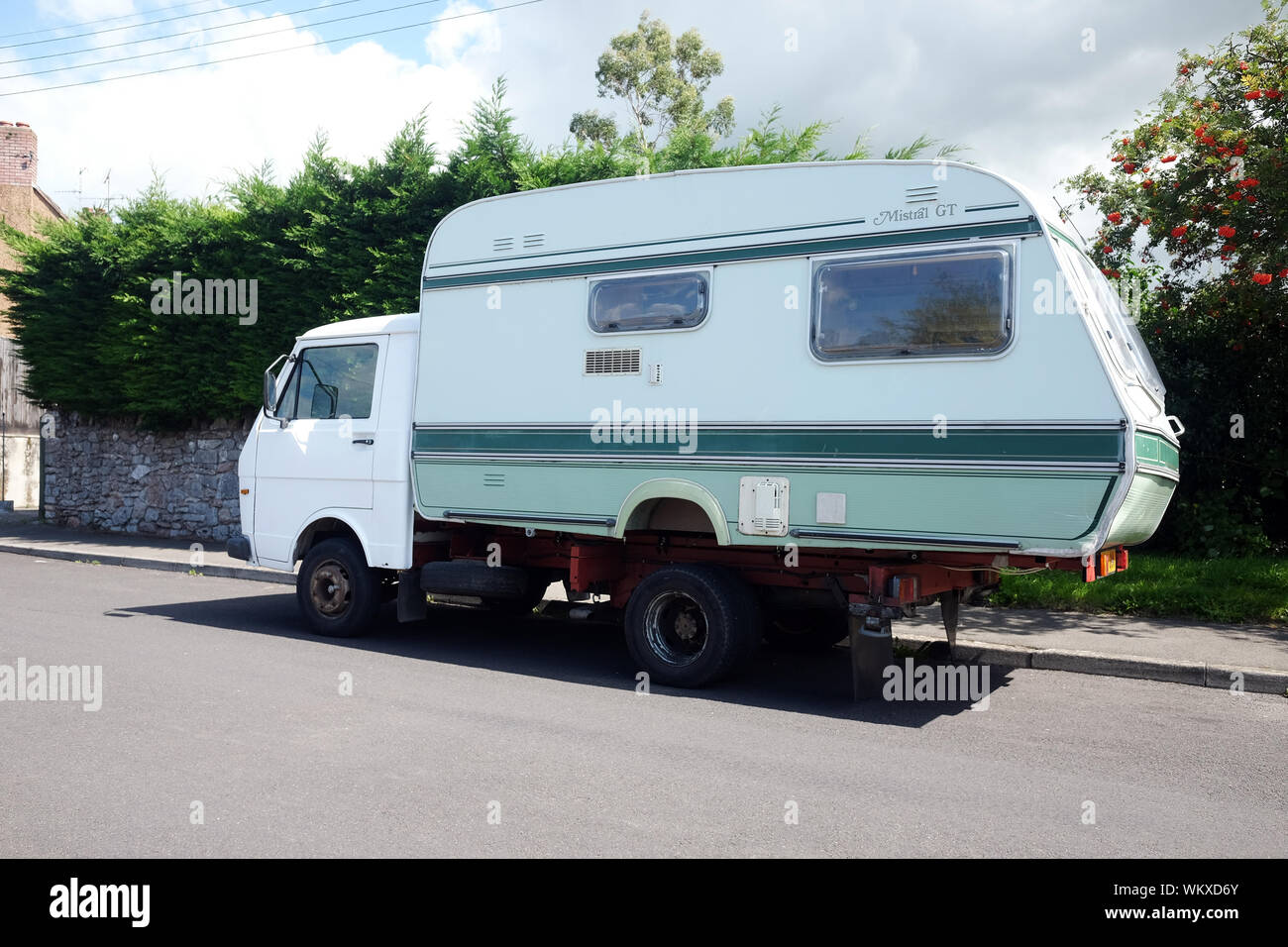 Septembert 2019 - An old caravan on the back off a small truck, used for holidays and vacations Stock Photo