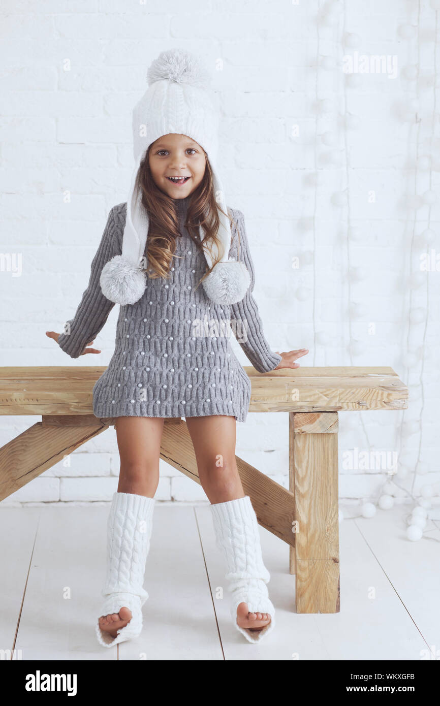 Cute little girl 6 years old wearing knitted trendy winter clothes