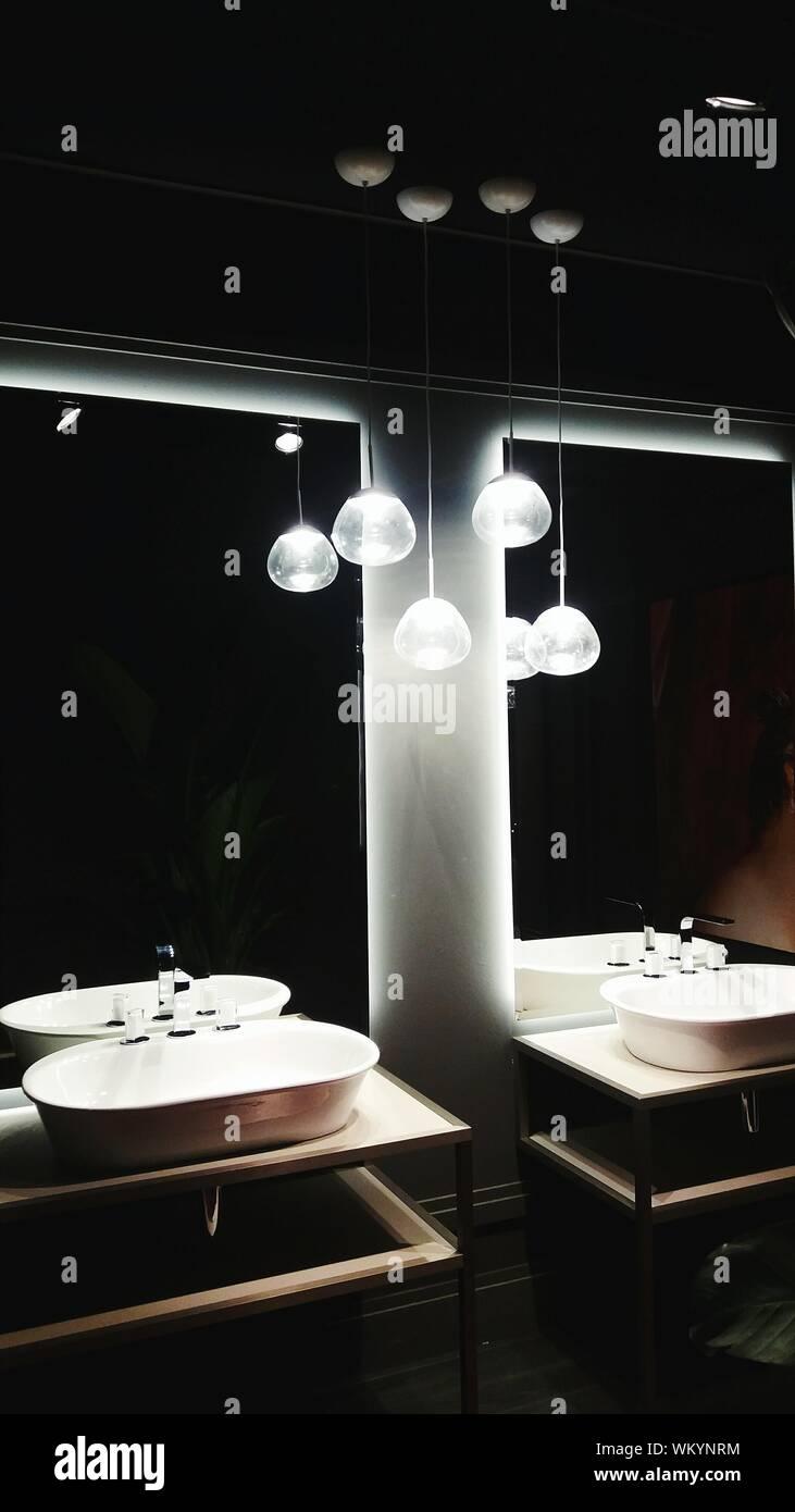 Illuminated Pendant Lights In Modern Bathroom Stock Photo Alamy