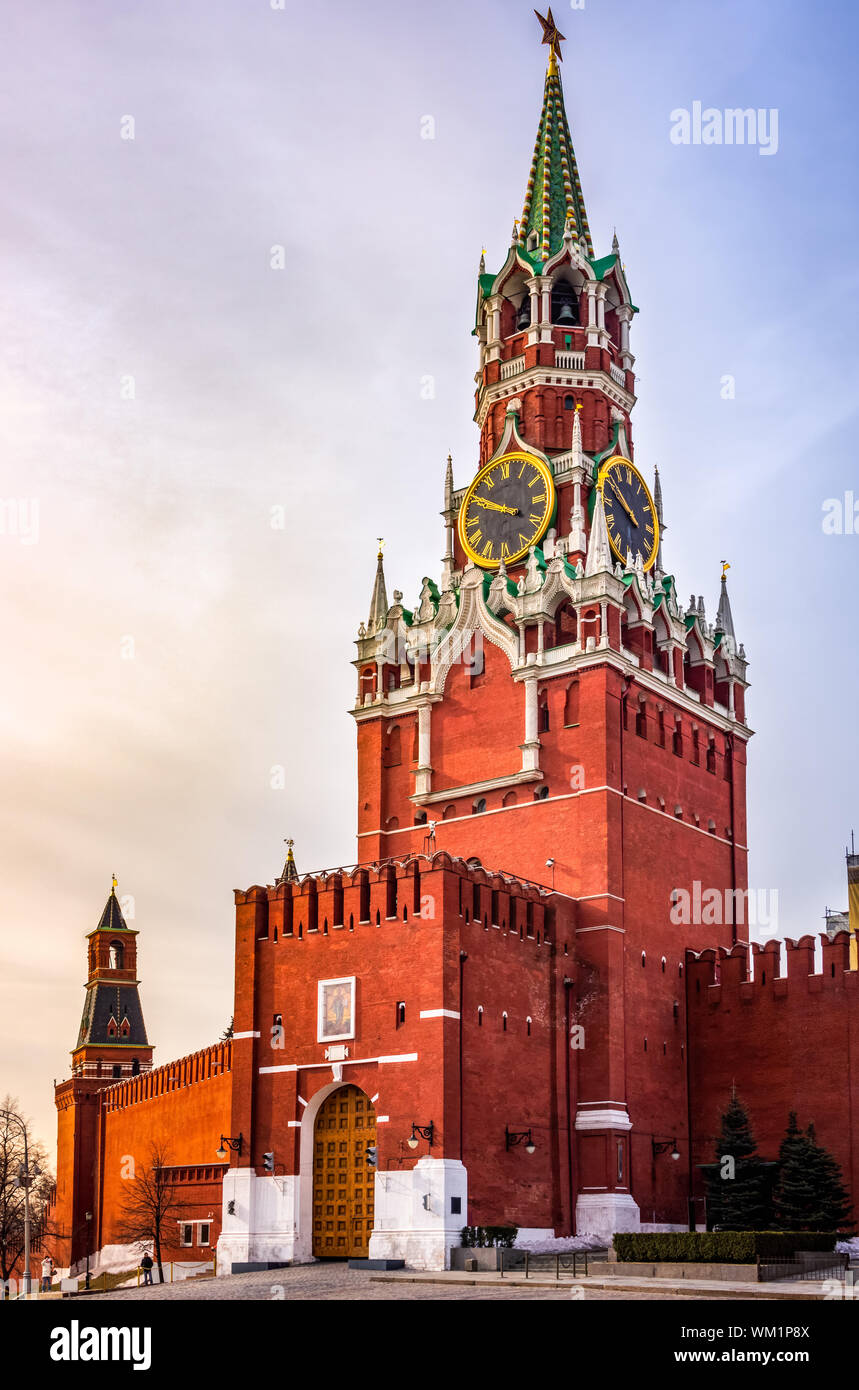 Beautiful Spasskaya Tower and The Tsars Tower with Kremlin walls in Moscow at sunrise, Russia Stock Photo